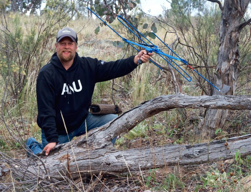 Snake researcher Gavin Smith with telemetry system in bush.